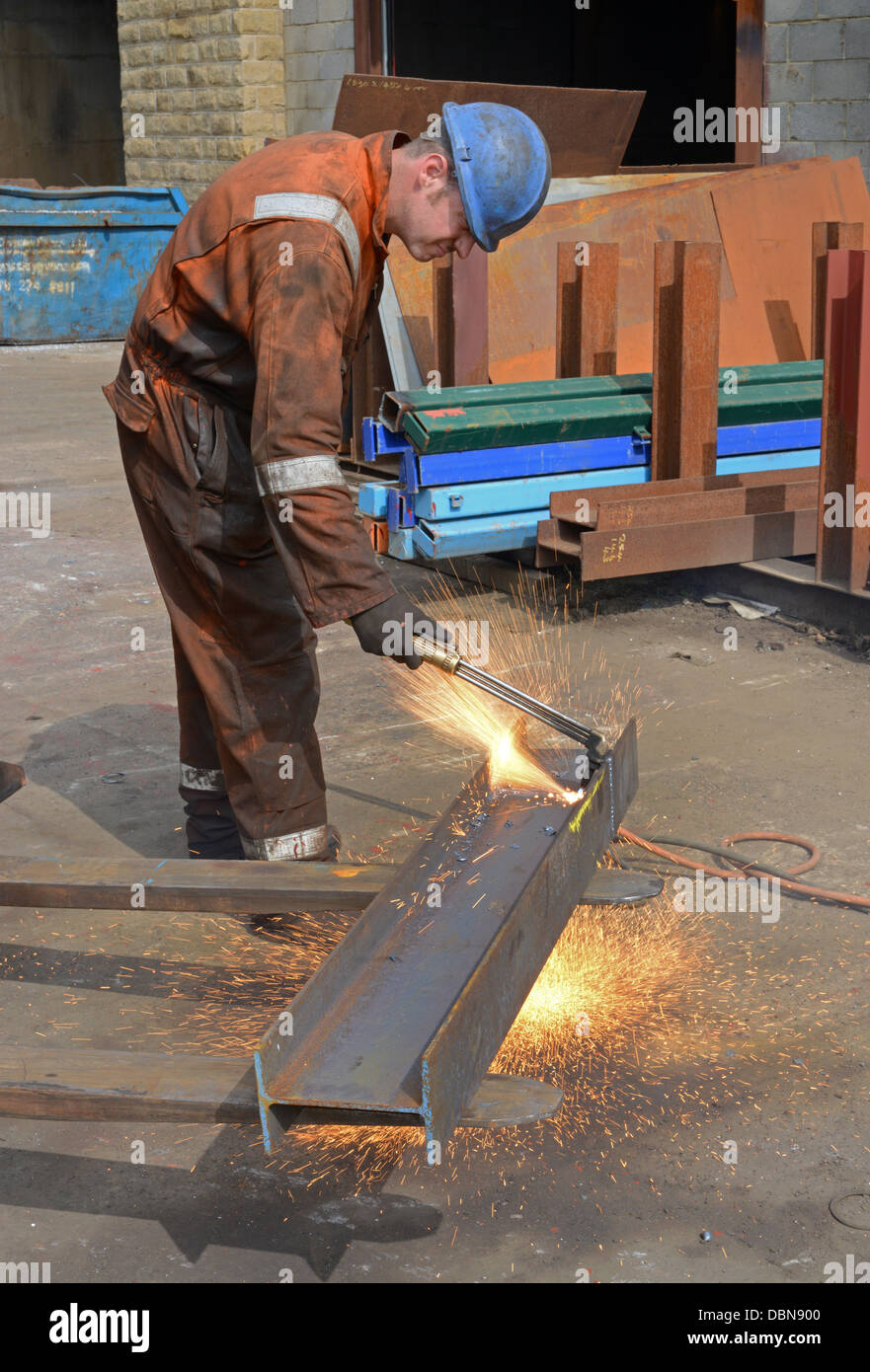 engineer using oxyacetylene torch to cut length of steel to size Stock Photo