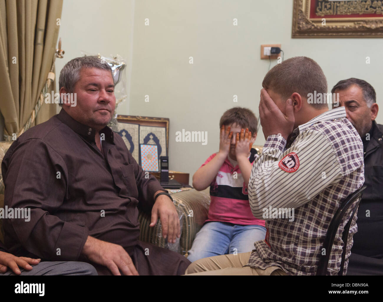 A father and 14 year old son celebrate the son's wedding to a 13 year old  bride in Aleppo, Syria.