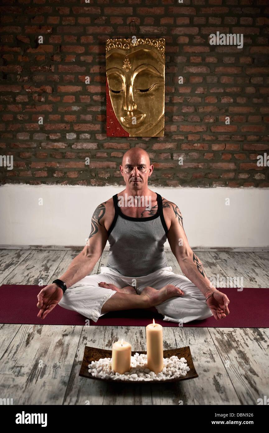 Man Practising Yoga, Lotus Pose - Stock Image