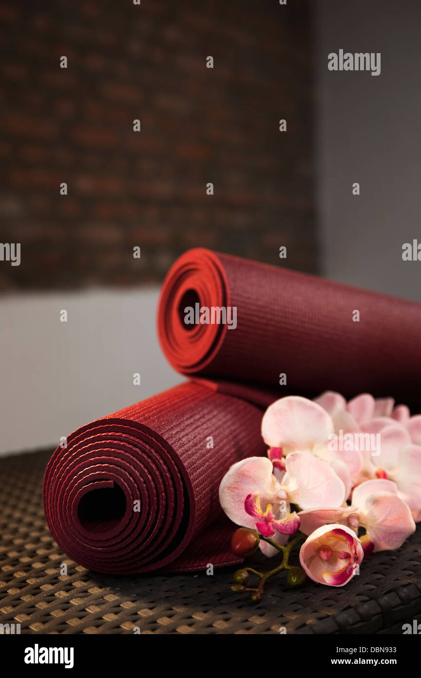 Yoga Mats And Orchids, Close-up - Stock Image