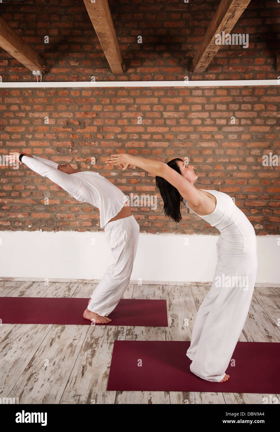 Couple in Yoga Pose - Stock Image