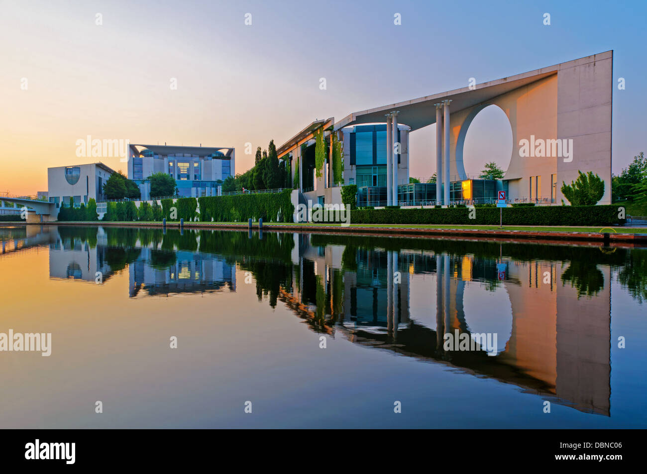Bundeskanzleramt in Berlin, Germany, with reflection in Spree river at sunrise Stock Photo