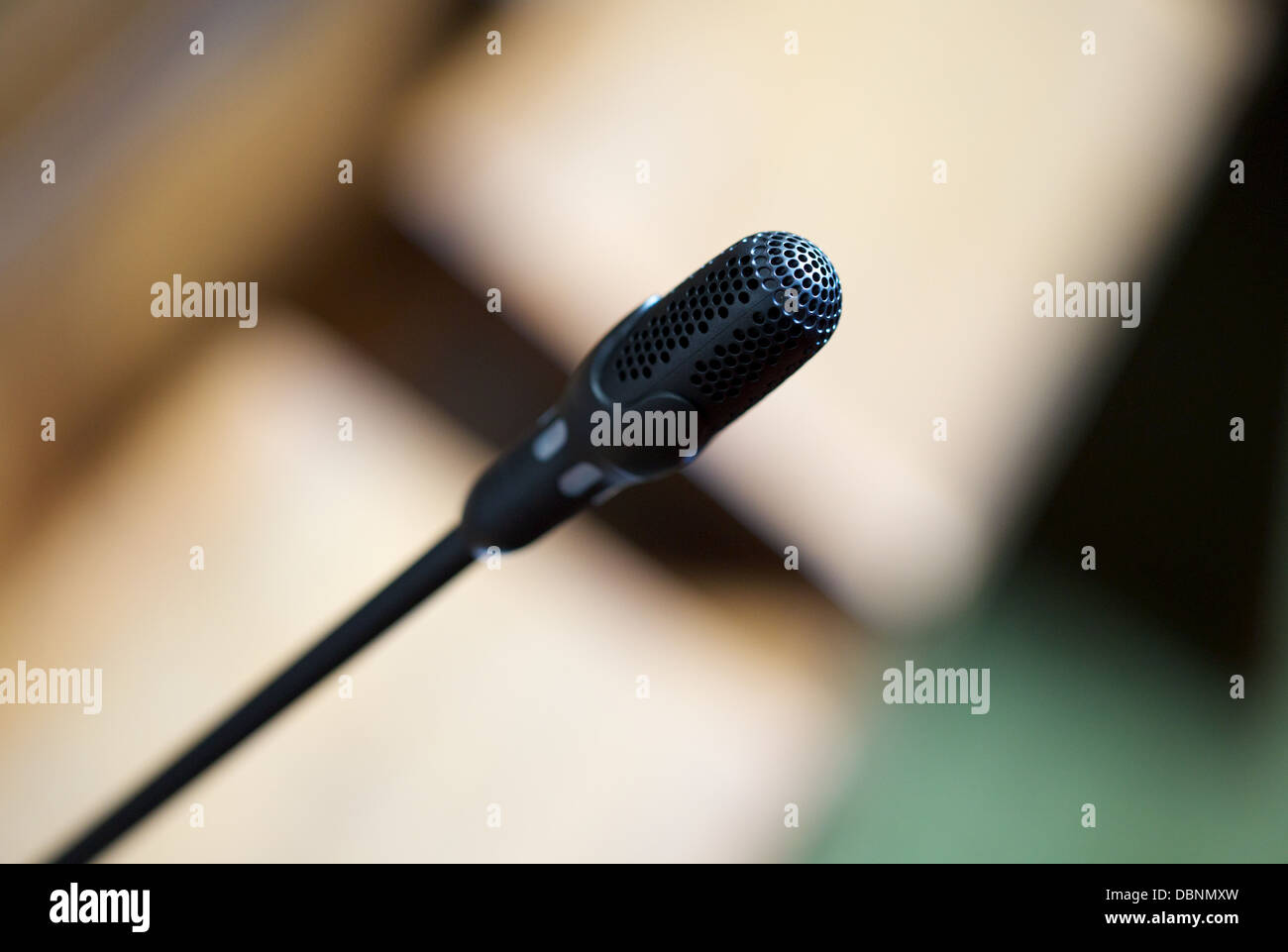 A speaker's microphone in a council chamber - Stock Image