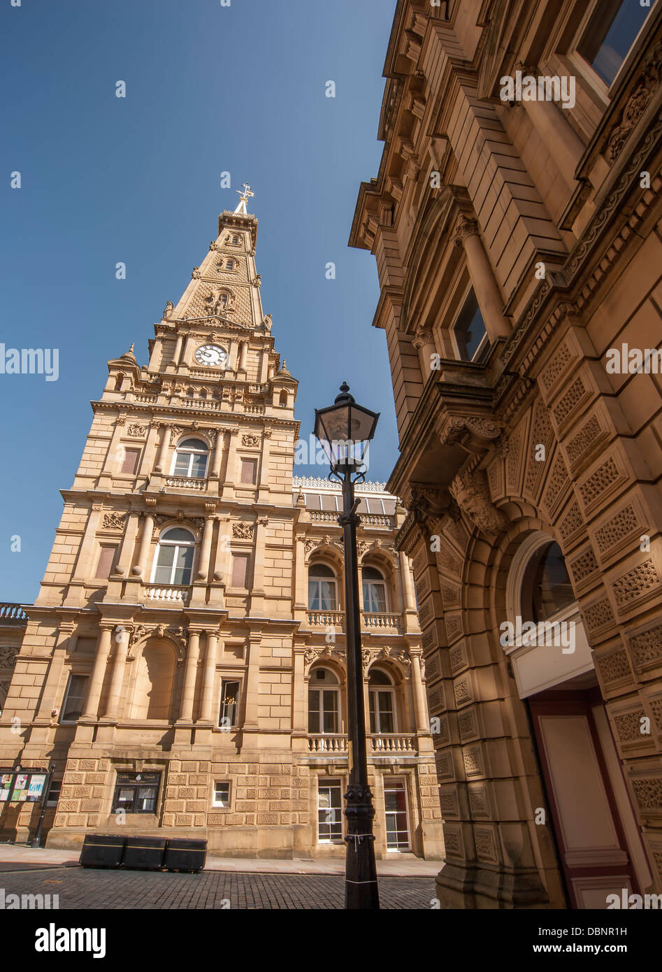 the impressive south facade of Halifax's sandstone built town hall - Stock Image