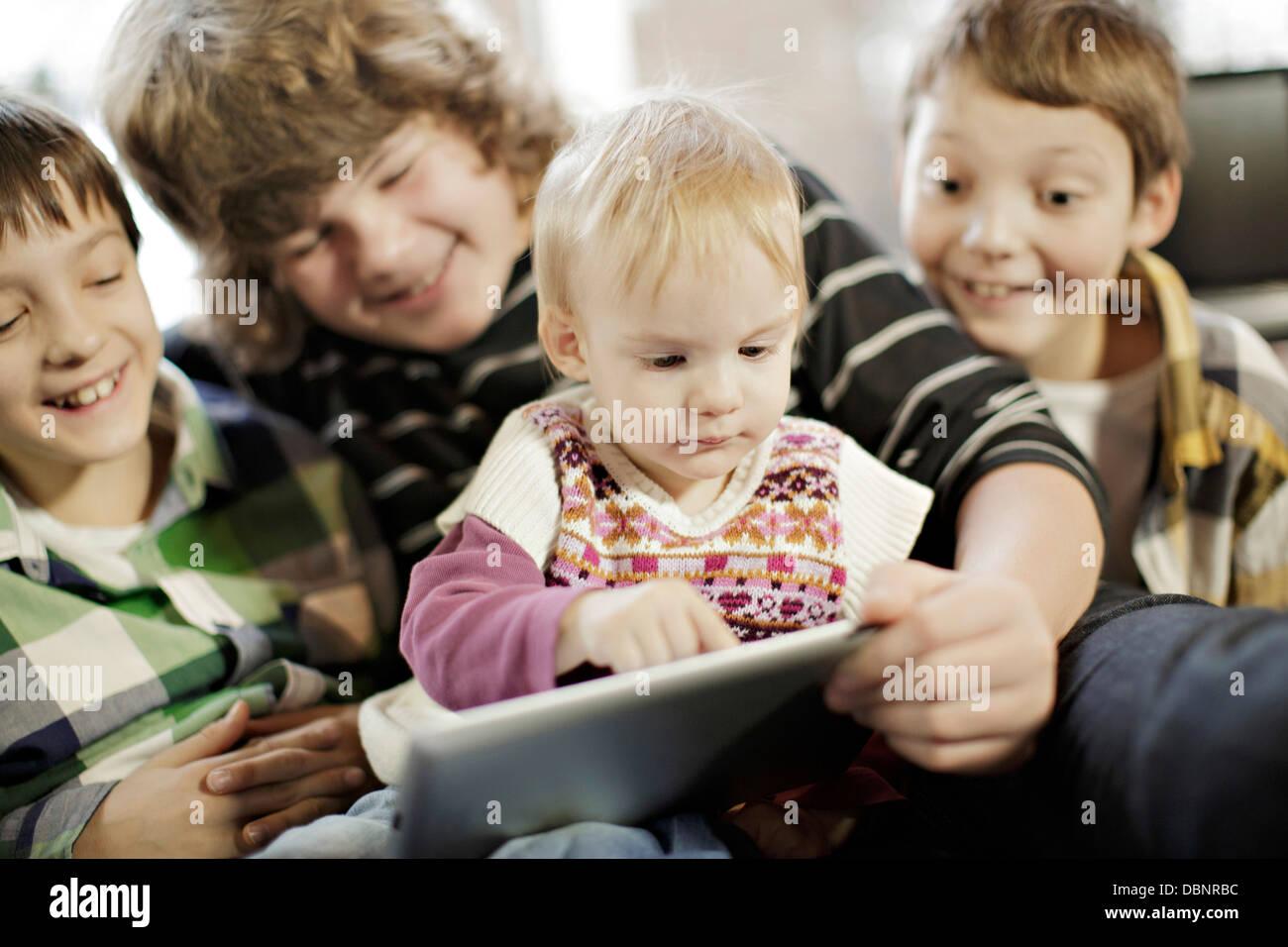 Children using digital tablet, Osijek, Croatia, Europe - Stock Image