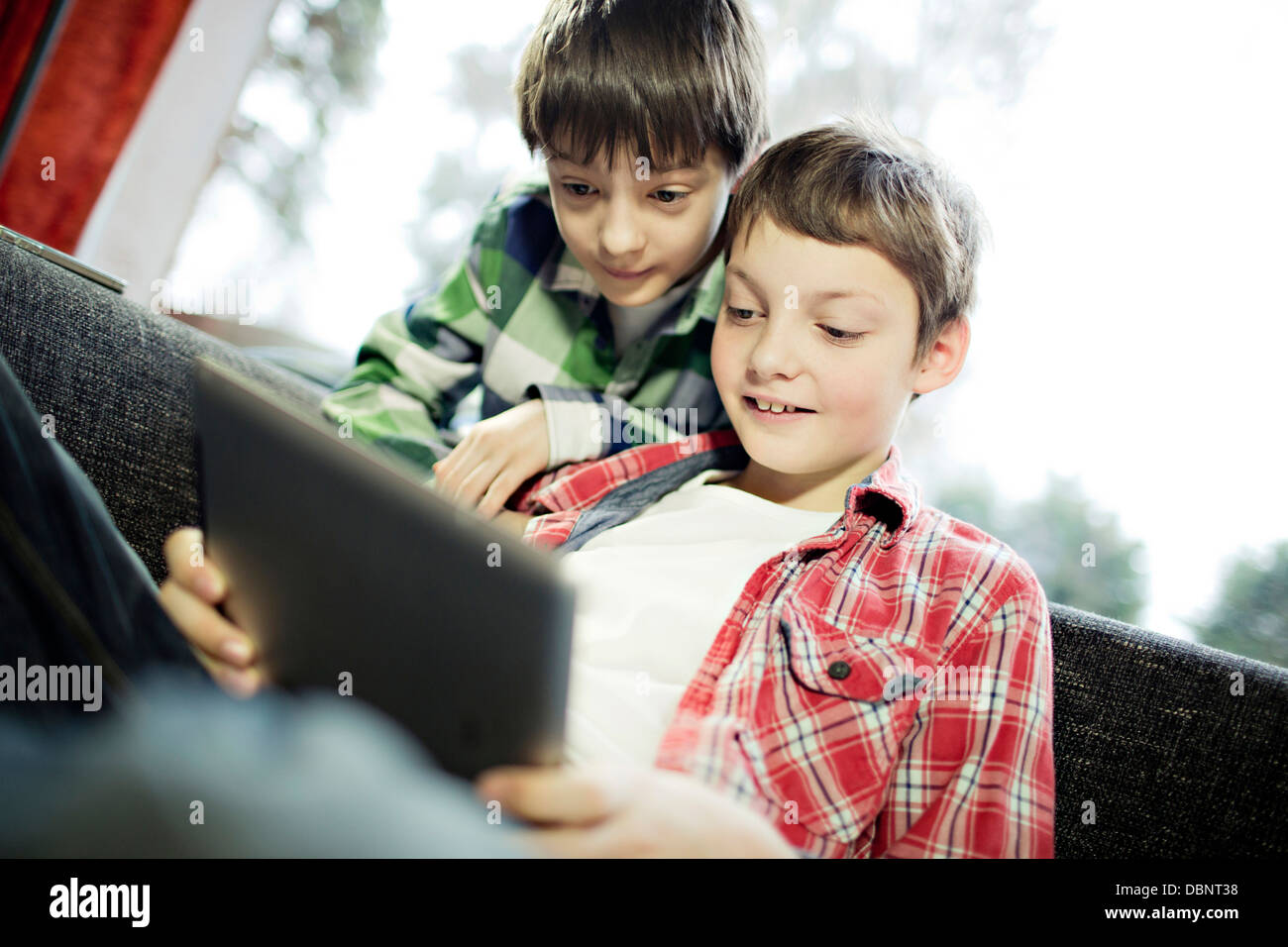 Two boys using digital tablet, Osijek, Croatia, Europe - Stock Image