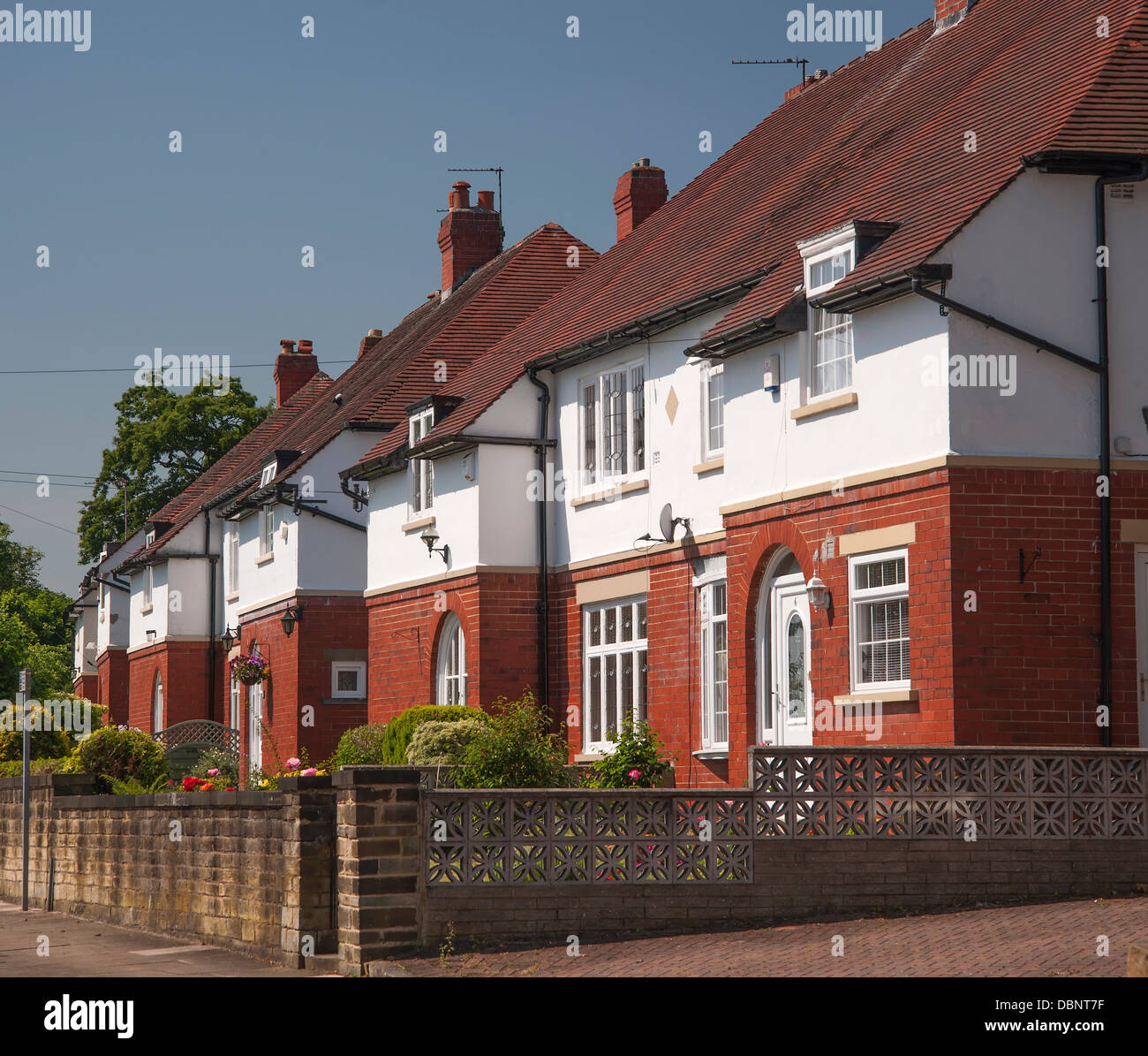 brick and render middle class housing - Stock Image