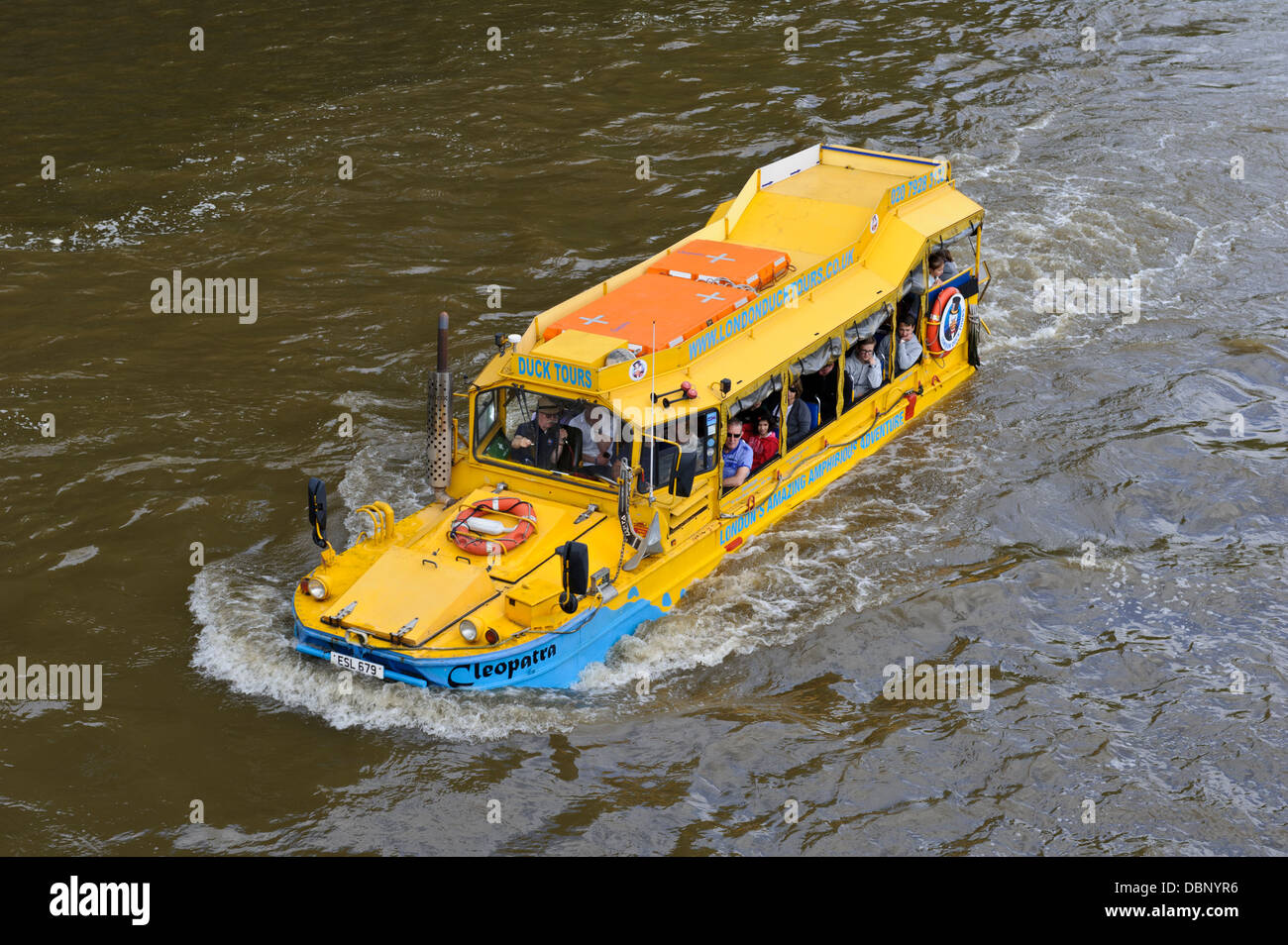 Tourists in amphibious vehicle on the Thames river, London, England, United Kingdom. - Stock Image