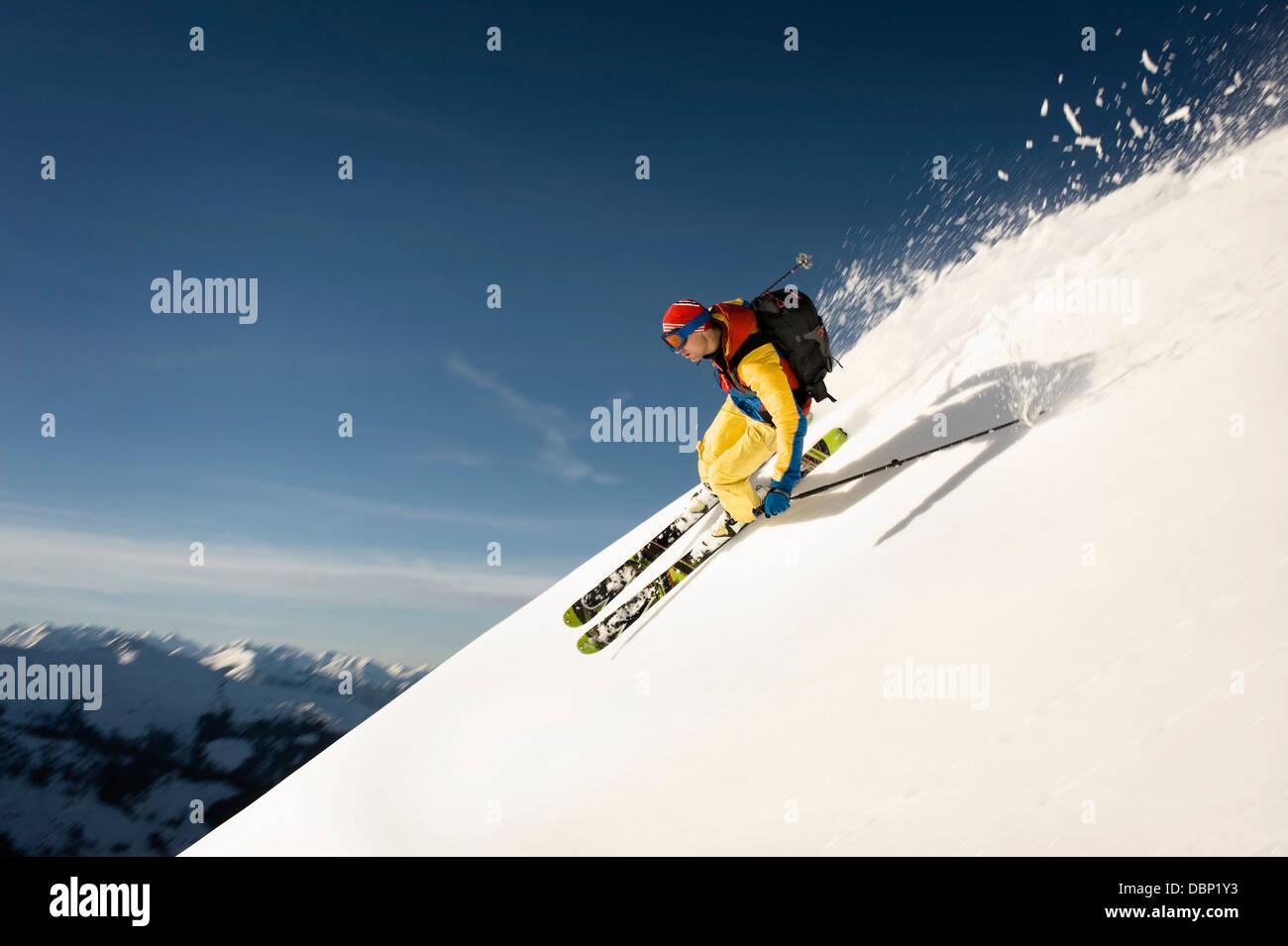 Backcountry skier skiing downhill, Alpbachtal, Tyrol, Austria, Europe Stock Photo