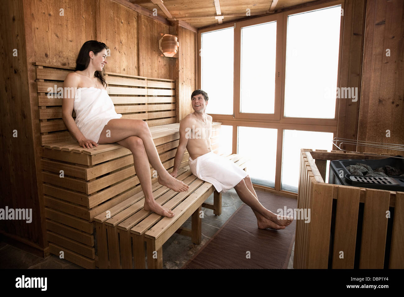 Young couple relaxes in sauna, Salzburger Land, Austria, Europe - Stock Image