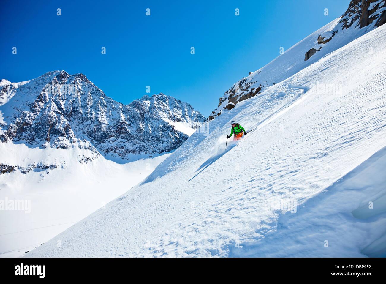 Female skier skiing downhill, Stubai, Tyrol, Austria - Stock Image