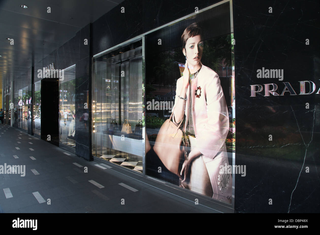 Prada shop front store singapore orchard road retail shopping - Stock Image