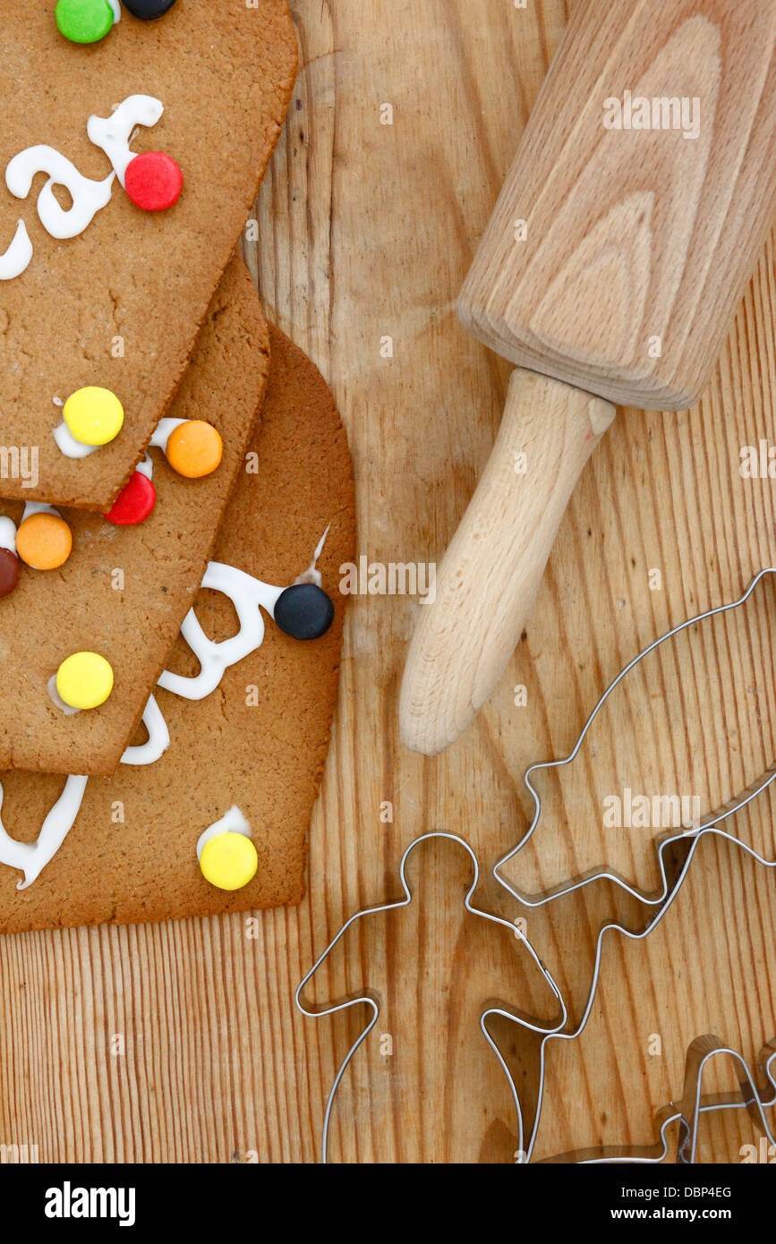 Rolling pins and cookies on cutting board Stock Photo