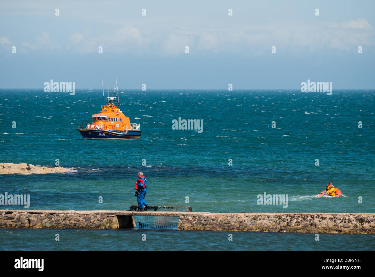 Millisle lagoon, Co Down, Northern Ireland, UK. 2nd August 2013. Saxon, the Donaghadee RNLI Lifeboat comes to the - Stock Image