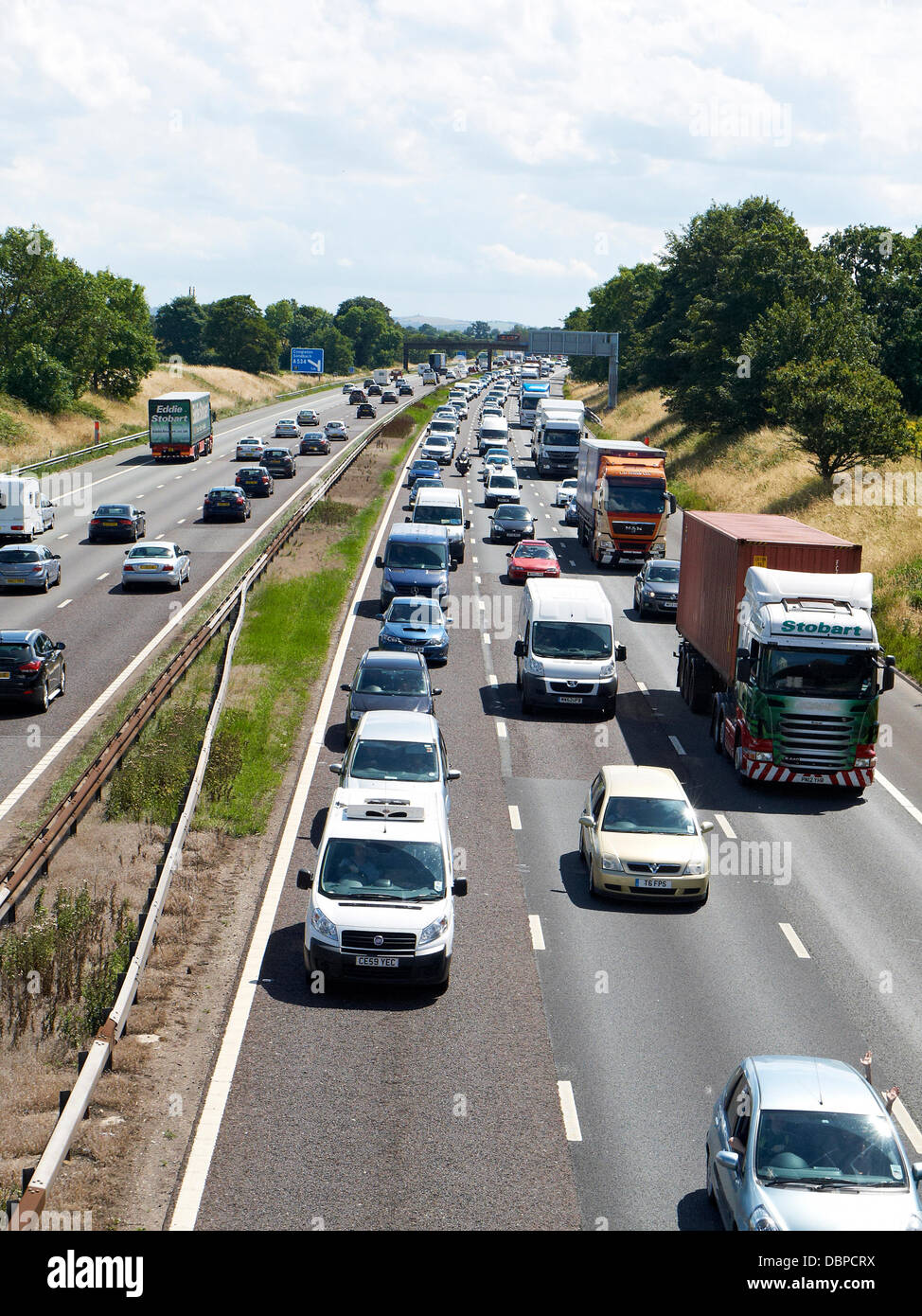 Sandbach, Cheshire, UK . 02nd Aug, 2013. 14.00 PM, Heavy traffic getaway madness on the M6 motorway looking south - Stock Image