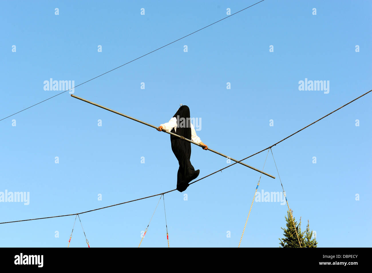 Ropedancer's performance in a black bag - Stock Image