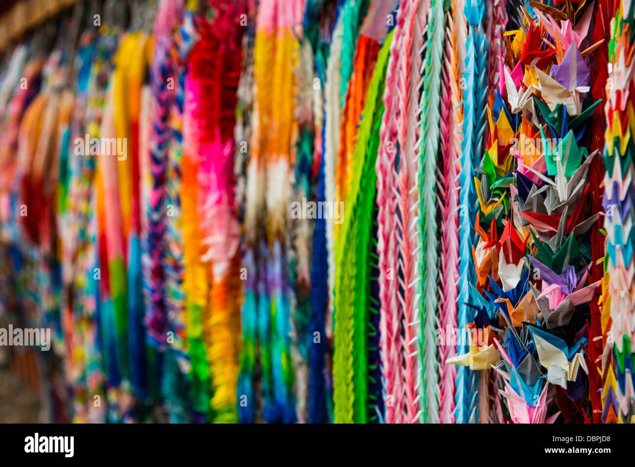 Colourful prayer ribbons at the Endless Red Gates of Kyoto's Fushimi Inari, Kyoto, Japan, Asia - Stock Image