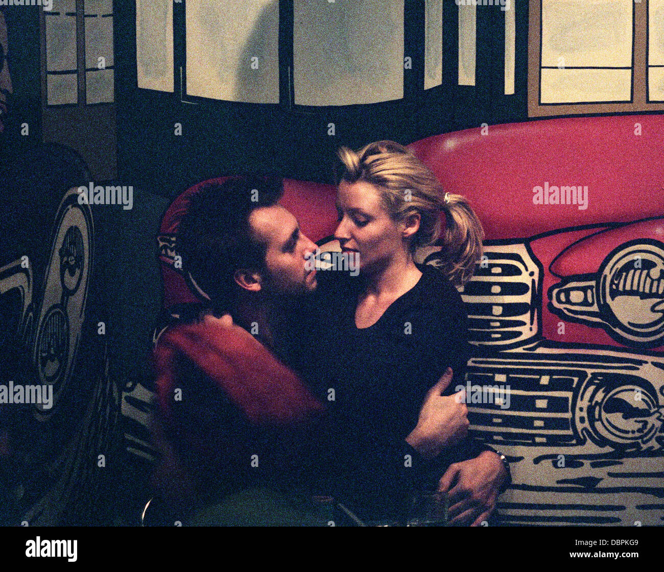 Dannii Minogue and boyfriend Steve Shaw enjoy a smooch in an Chelsea Cafe, London, Britain December 1996 - Stock Image