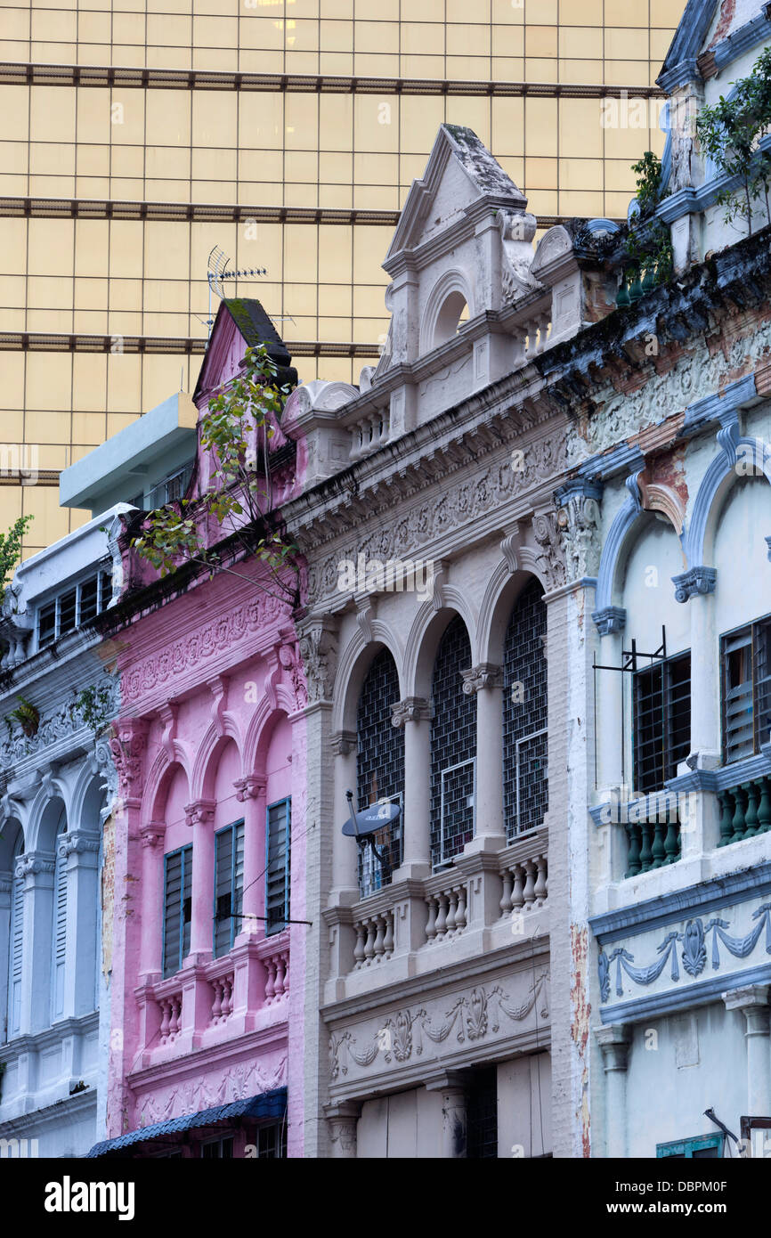 Colonial era architecture with glass office building behind, Kuala Lumpur, Malaysia, Southeast Asia, Asia - Stock Image