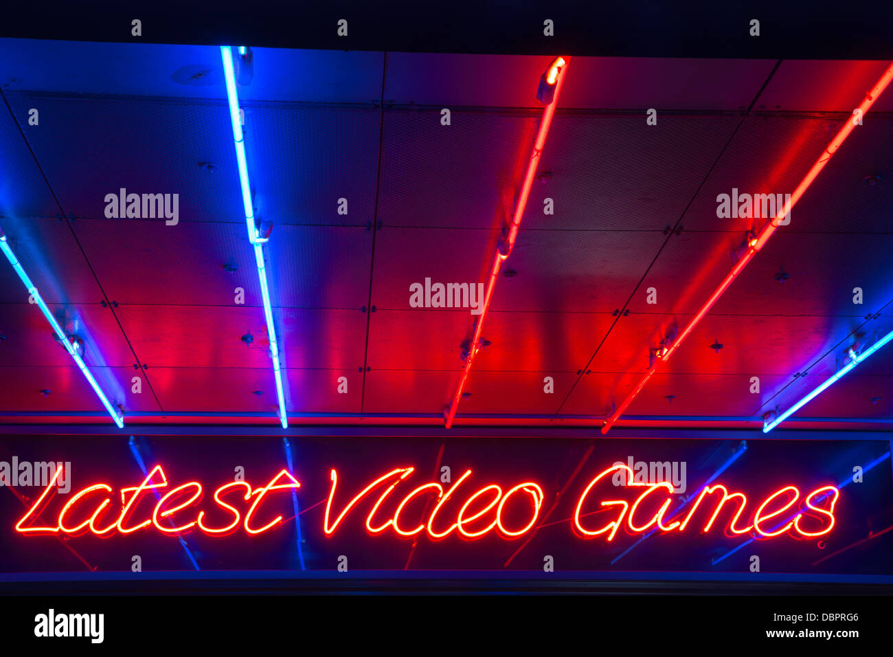 31/07/2013 Latest Video Games neon sign at Electric Avenue amusement arcade on the seafront in Southend-on-Sea - Stock Image