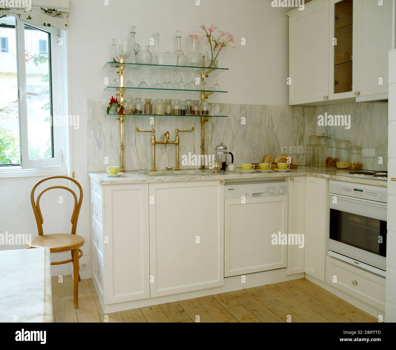 Exceptionnel Glassware On Glass Shelves In White Coastal Kitchen With Antique Bentwood  Chair And Fitted Dishwasher And Oven