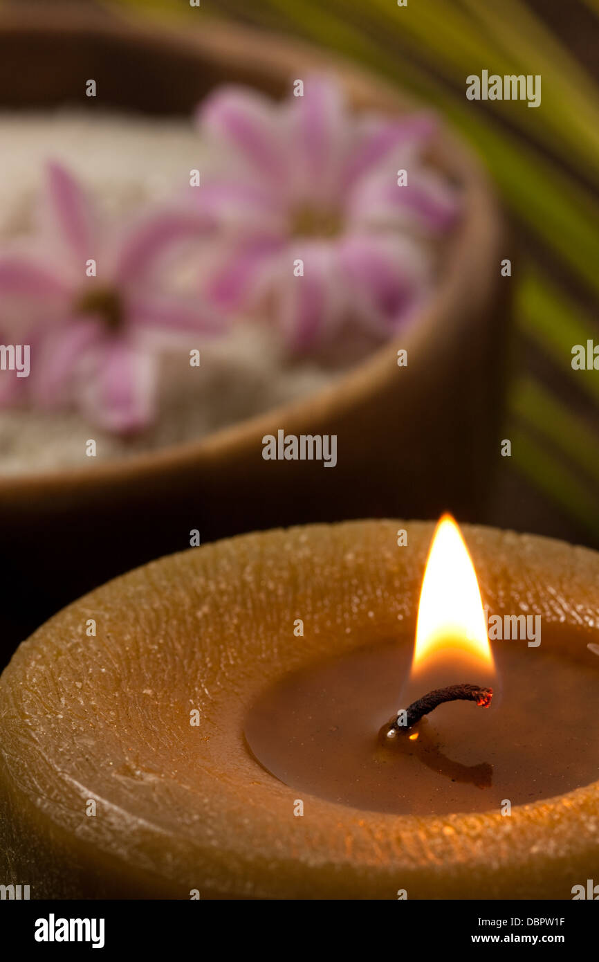 wellness concept - burning candle - Stock Image