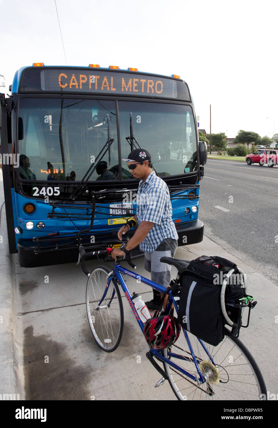 Morning Commuters Riding Bicycles Use Rack To Load Their Bikes Onto A Bus The Public Transportation In Austin Texas