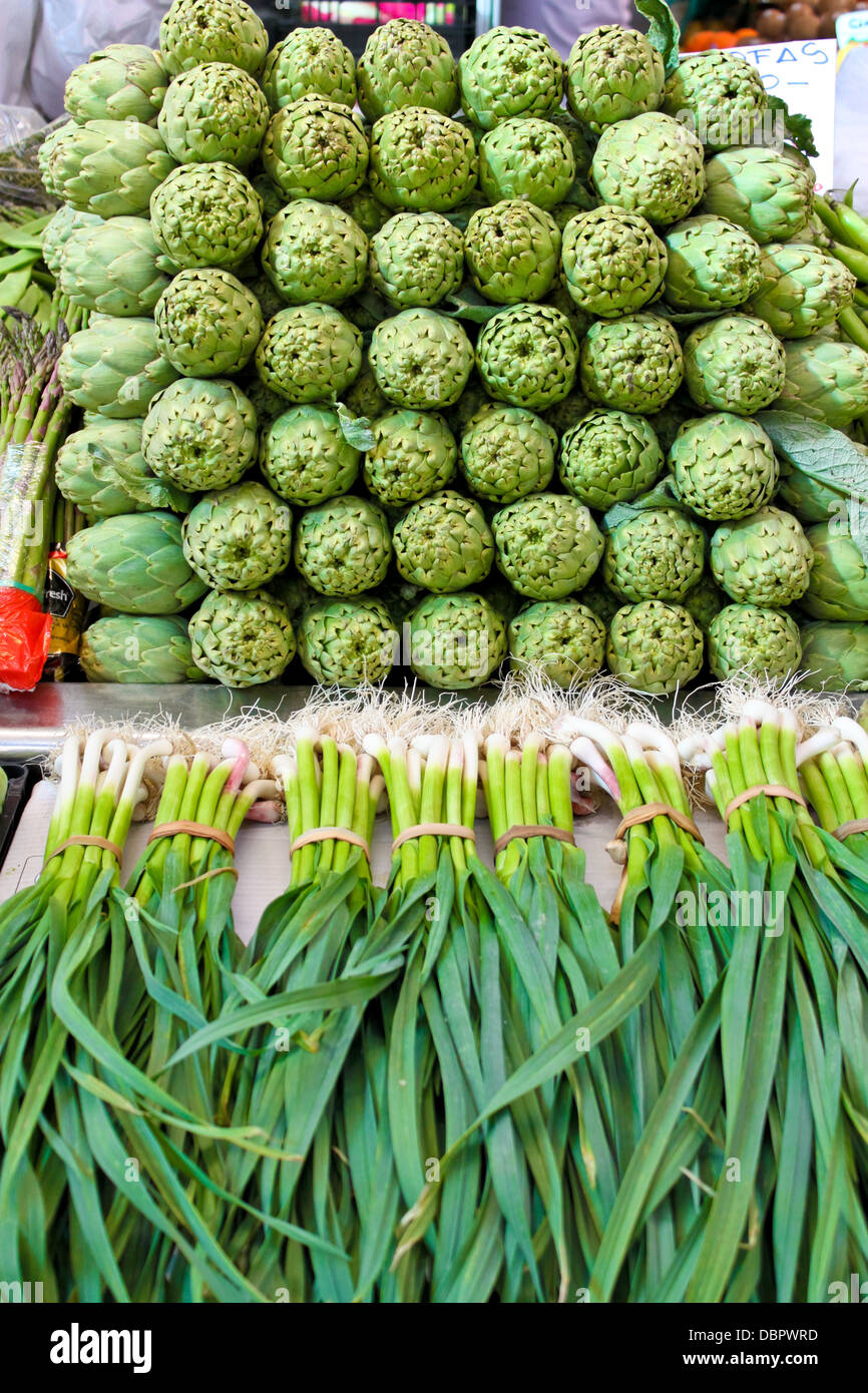 artichoke and young garlic on a Central market in Valencia, Spain - Stock Image