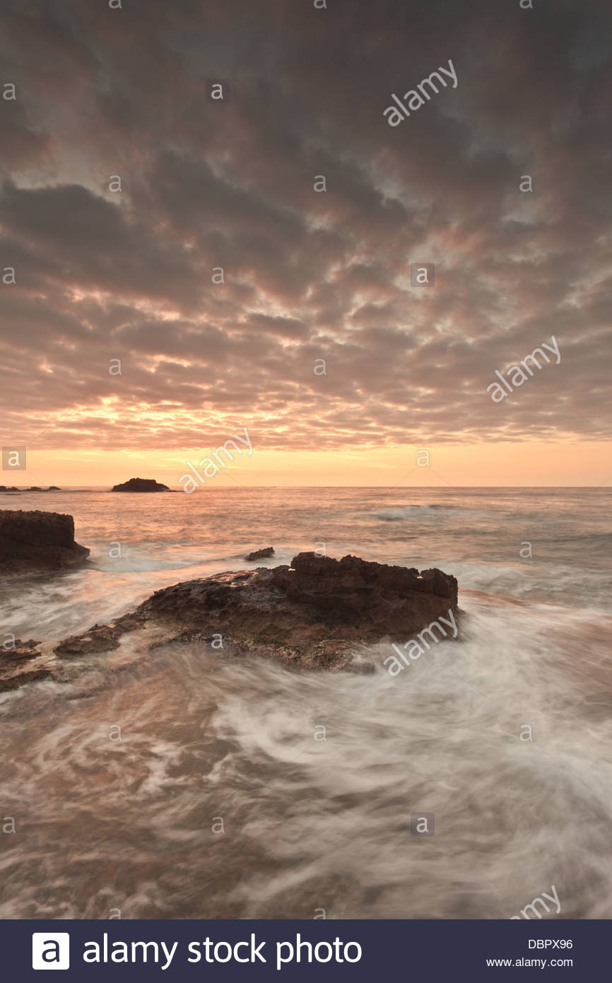 Rising sun at Cabo de Palos, murcia, Spain. Sunrise at the beach - Stock Image
