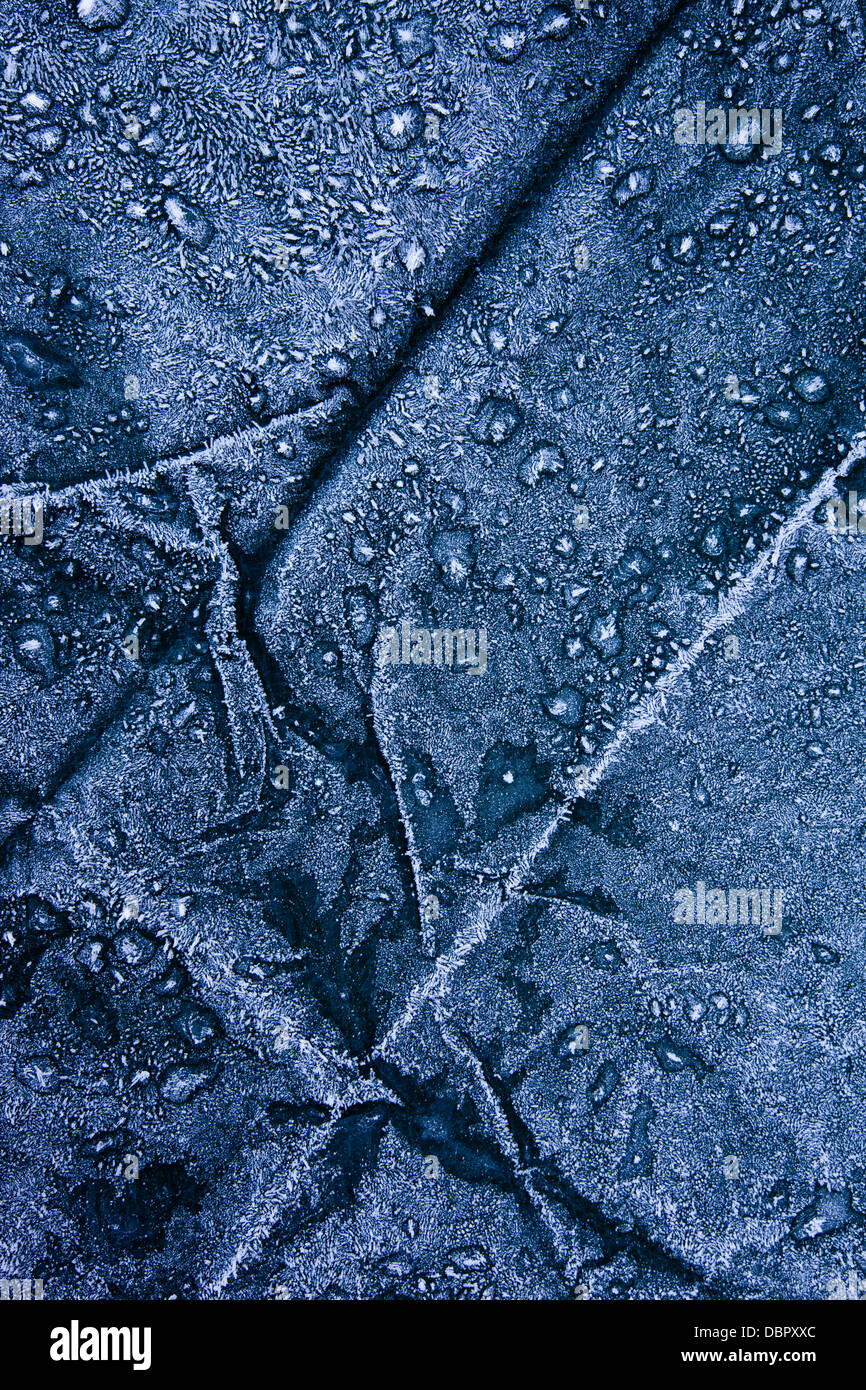 Close-up of frost covered tarpaulin. - Stock Image