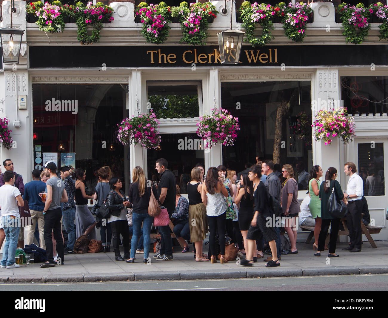 London pub with customers standing outside - Stock Image