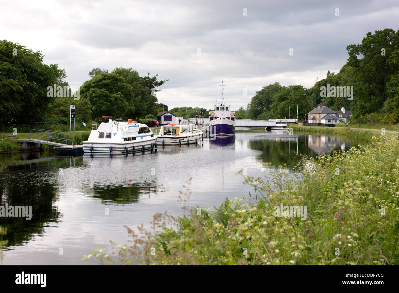 View towards Tomnahurich Bridge from the towpath on the Caledonian Canal near Inverness Scotland - Stock Image