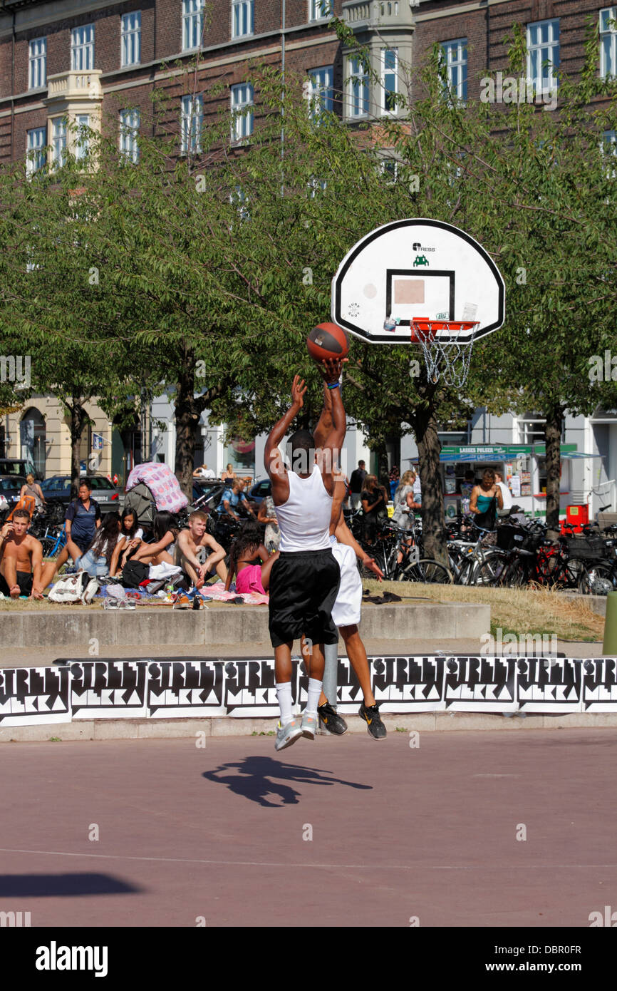 Various STREET activities taking place at Islands Brygge Copenhagen in a project called StreetMekka. Street basketball. Stock Photo