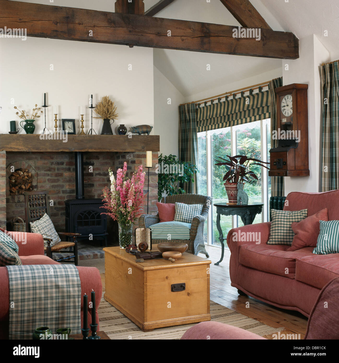 pink sofas and old pine chest used as a coffee table in living room stock photo 58898355 alamy. Black Bedroom Furniture Sets. Home Design Ideas