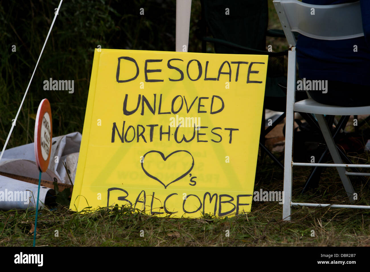 Balcombe, UK. 2nd August, 2013. Placard from the 'desolate unloved northwest' at protest against Cuadrilla - Stock Image