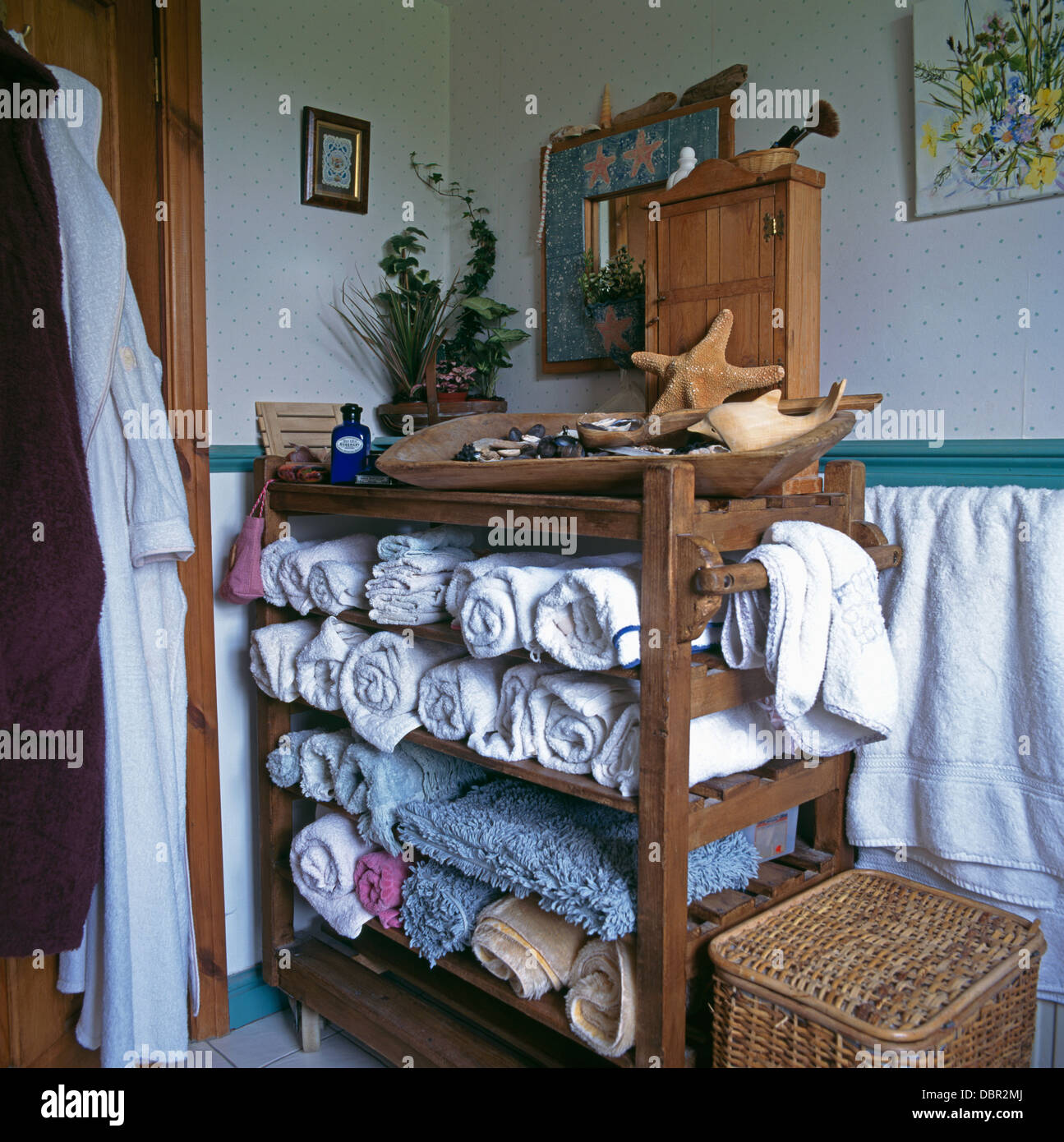 rolled towels stored on old baker s rack in cottage bathroom stock rh alamy com