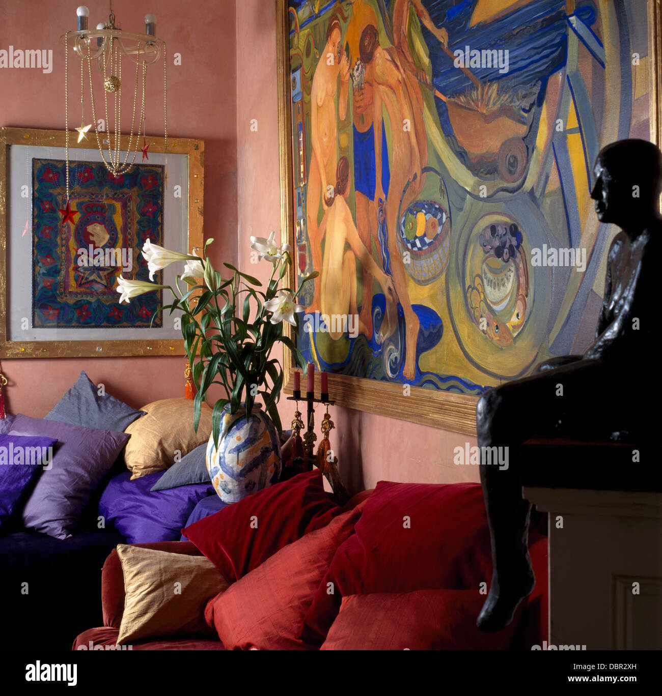 Colouful Painting Above Sofa And Armchair Piled With Red Velvet Stock Photo Alamy