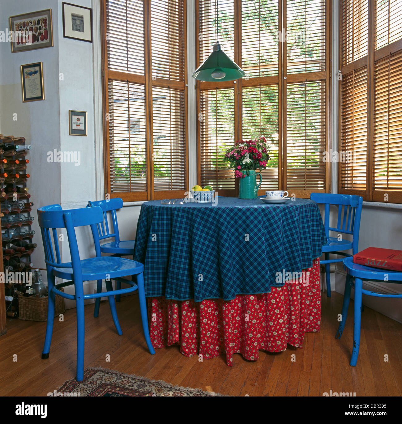 Superbe Bright Blue Painted Chairs At Table With Red And Blue Cloths In Front Of  Dining Room Window With Wooden Venetian Blind