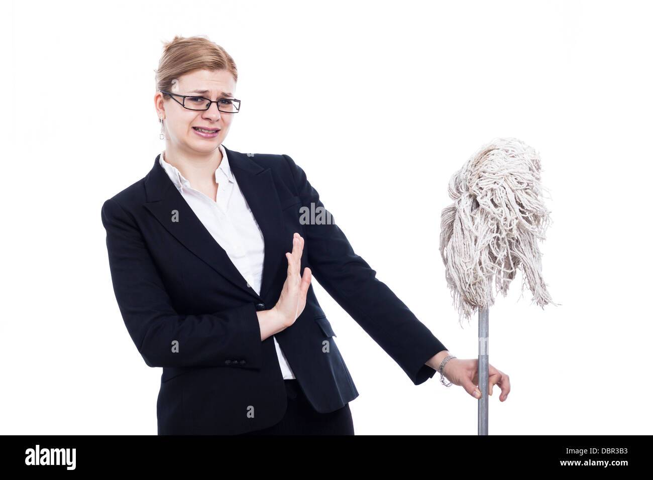 Unhappy businesswoman holding mop, isolated on white background. - Stock Image
