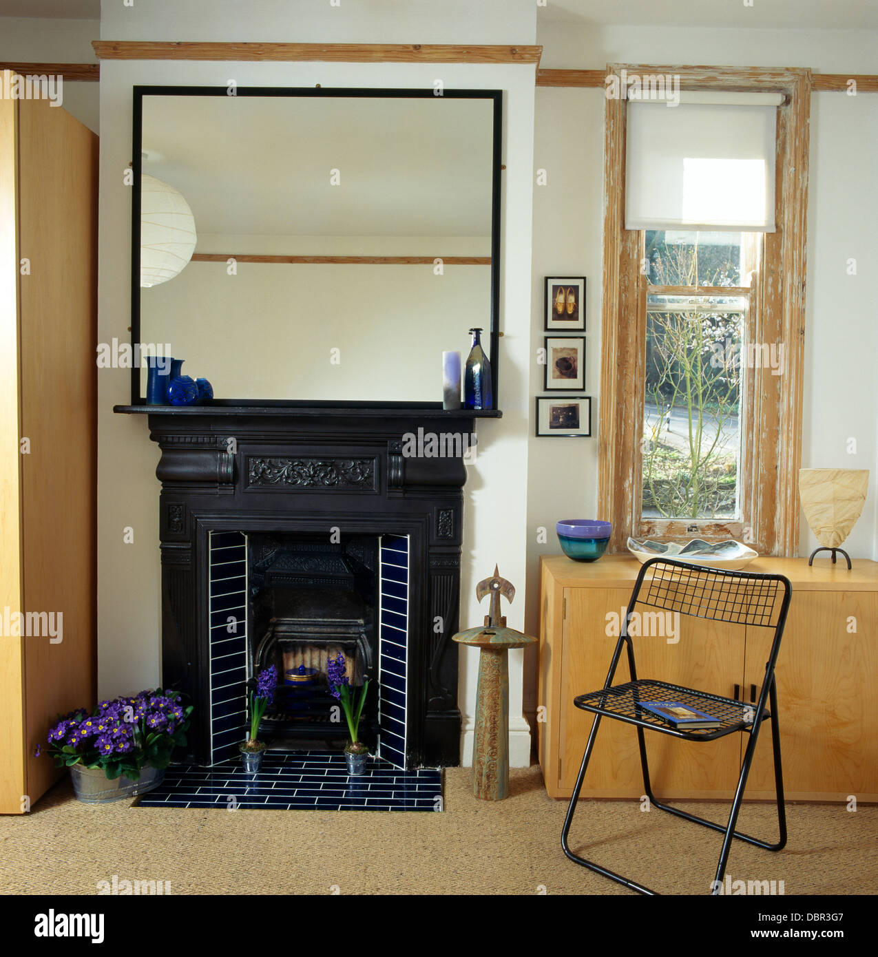 Large Mirror Above Black Cast Iron Edwardian Fireplace In Modern