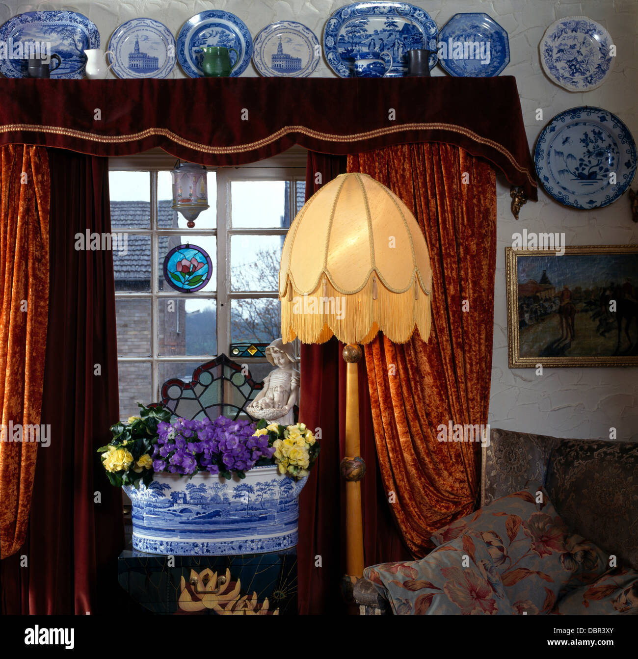 Blue White China On Wall Above Window With Red Brown Velvet Curtains Stock Photo Alamy