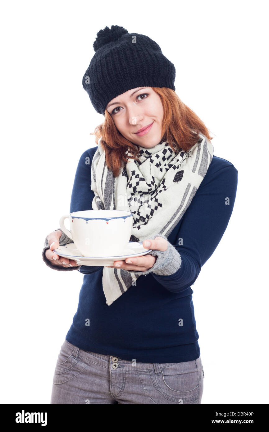 c40fb1e78614 Happy woman in winter clothes holding mug of tea or coffee
