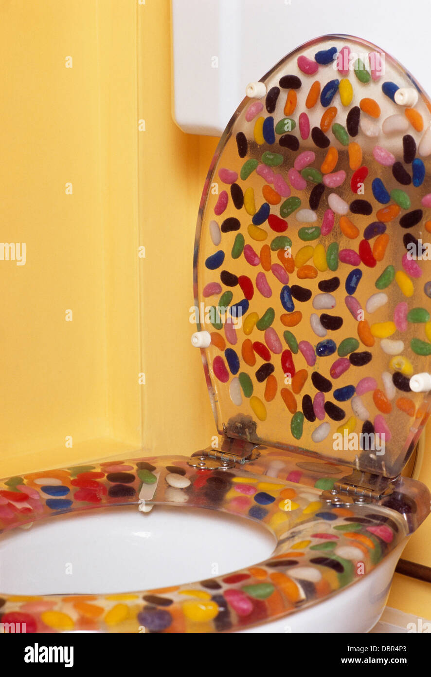Close-up of toilet with novelty acrylic jelly baby toilet seat Stock ...