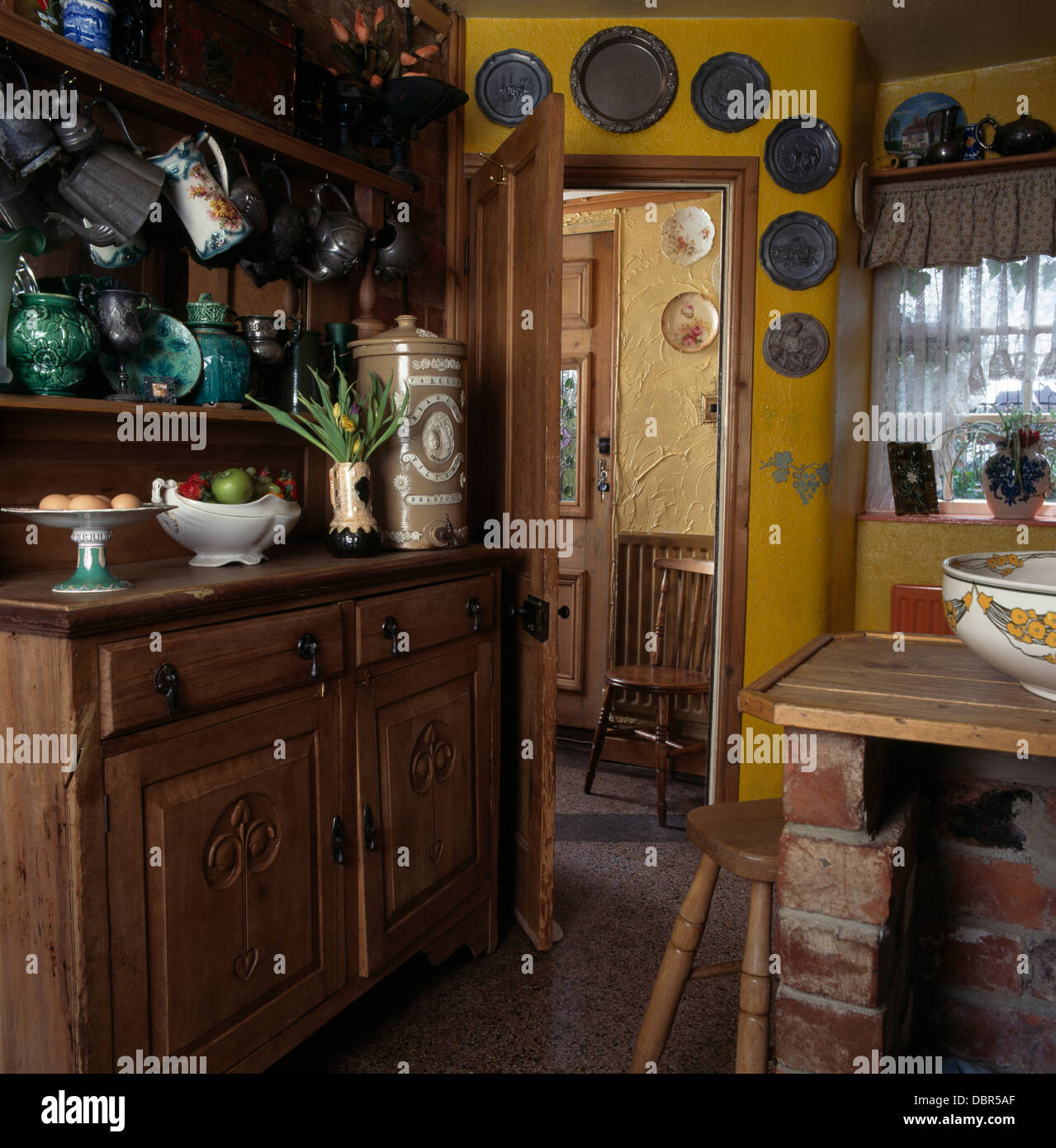 Collection Of Pewter Jugs On Old Pine Dresser In Retro Kitchen With