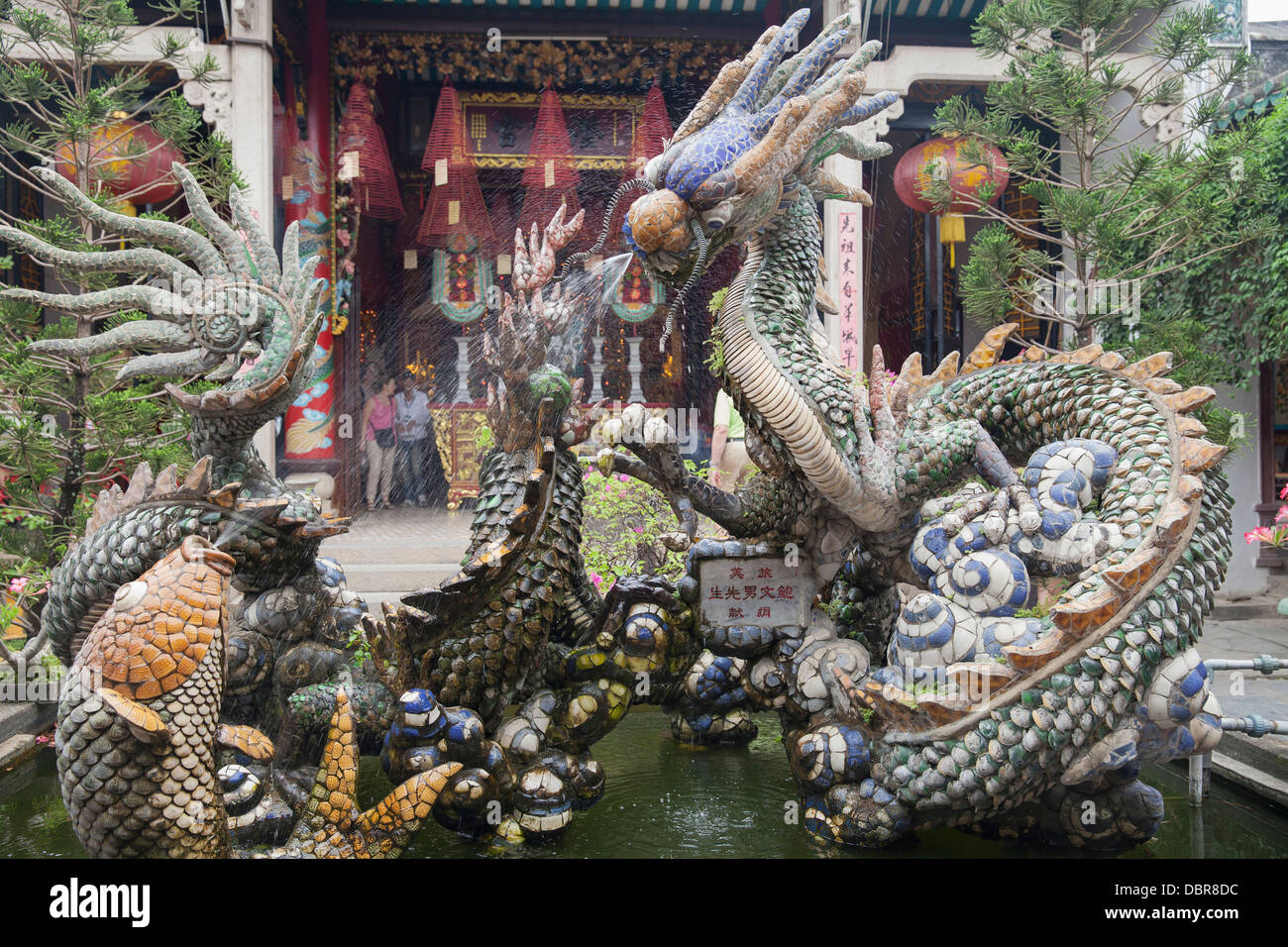 Dragon fountain in front of Quang Trieu Cantonese Assembly Hall, Hoi An, Vietnam, Southeast Asia - Stock Image