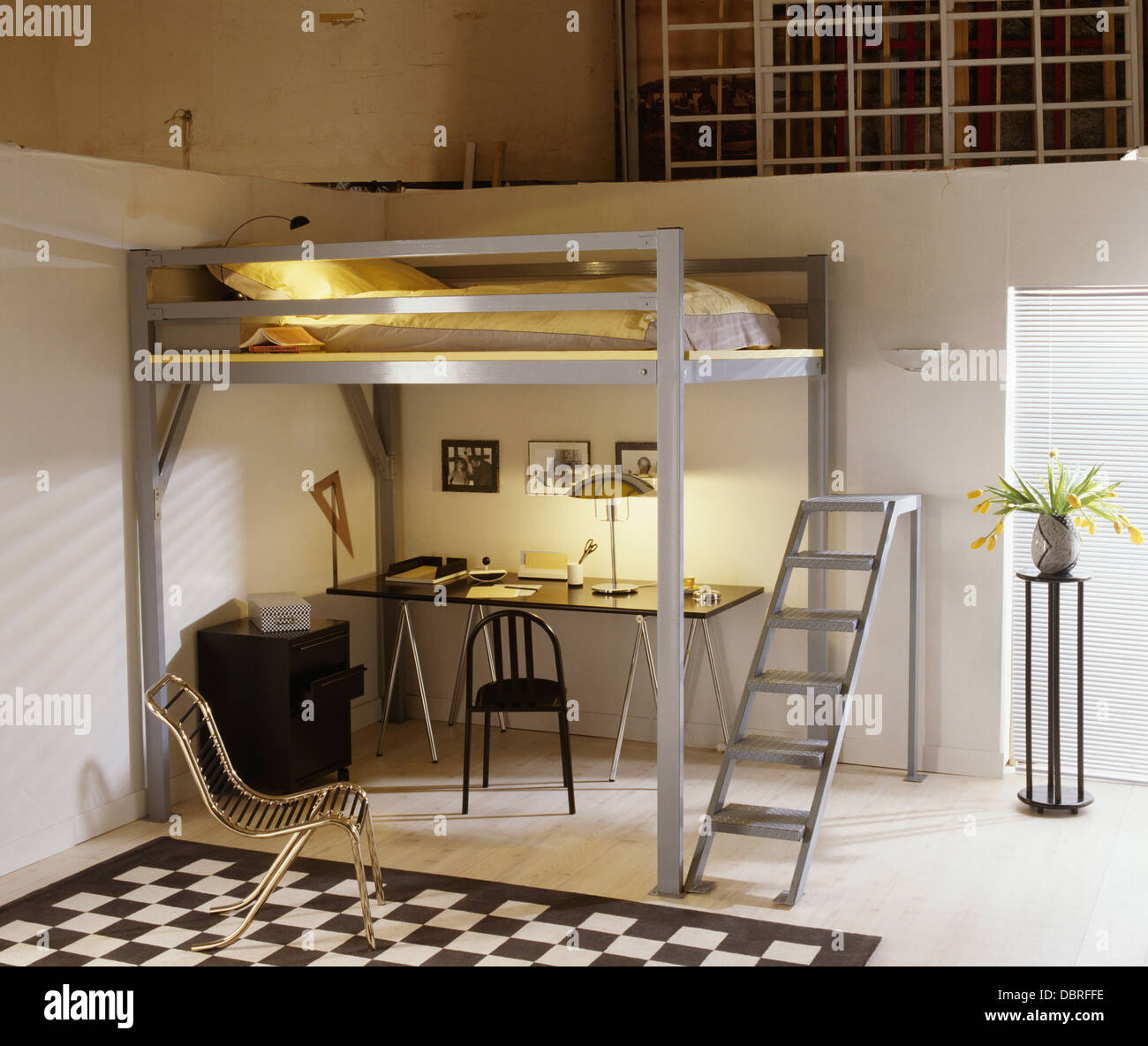 Metal Ladder To Bed On Small Platform Above Desk And Chair In Study Stock Photo Alamy