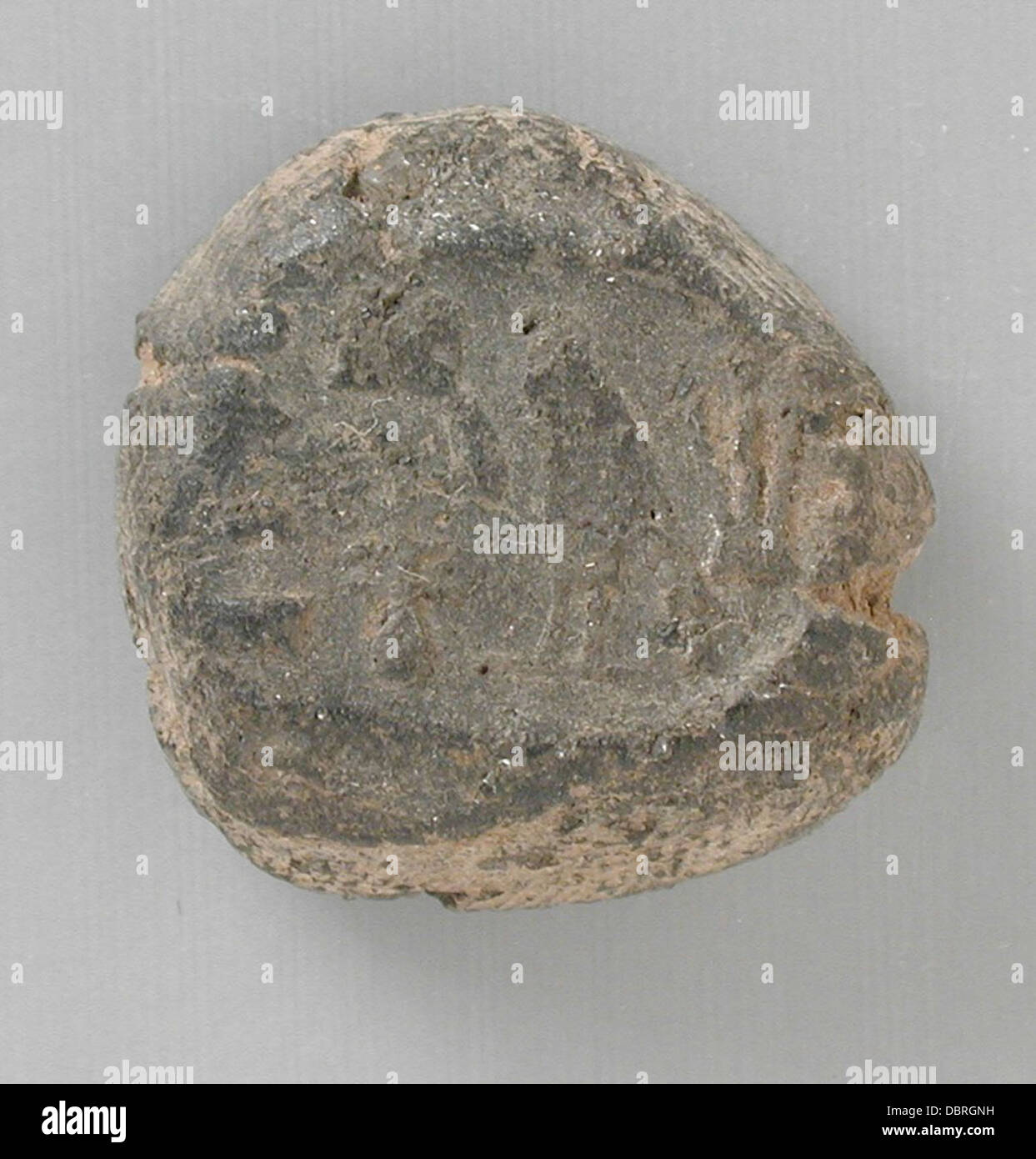 Broken Seal Impression with Remains of a Personal Name M.80.202.881 - Stock Image