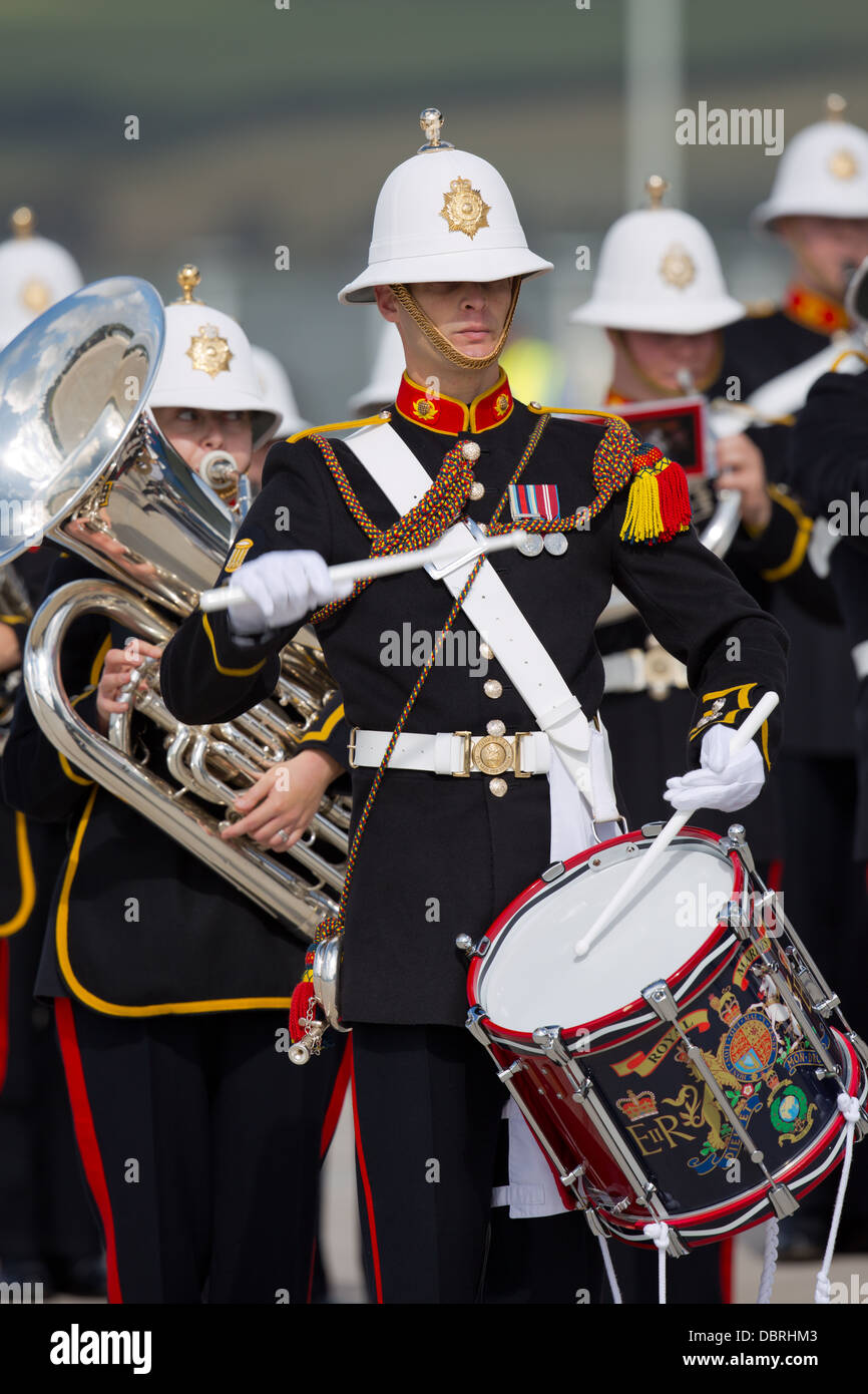 A drummer in the Royal Marines military band on parade at HMNB Devonport - Stock Image