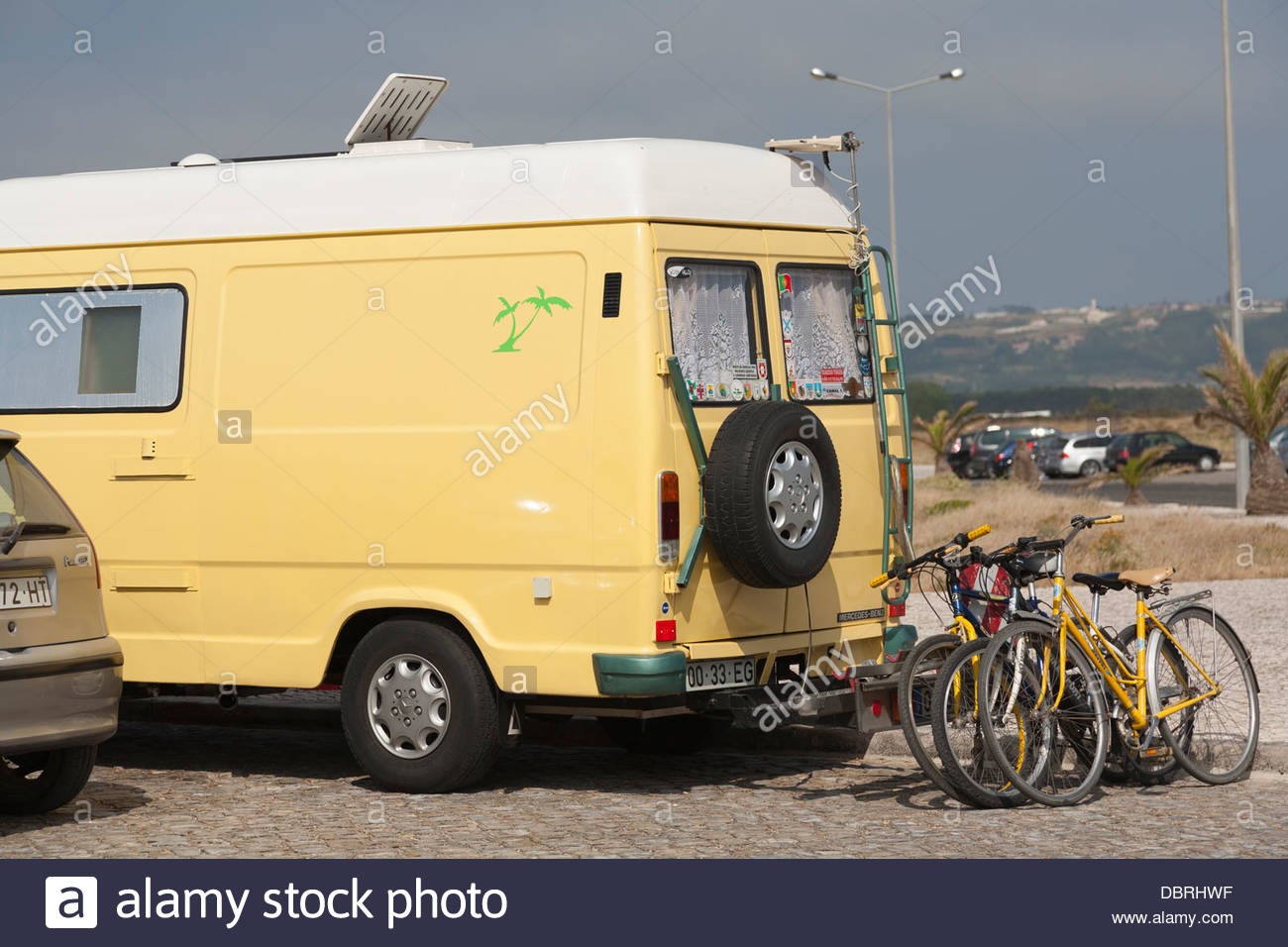 A small campervan parked and free camping in Sao Martinho do Porto Portugal - Stock Image