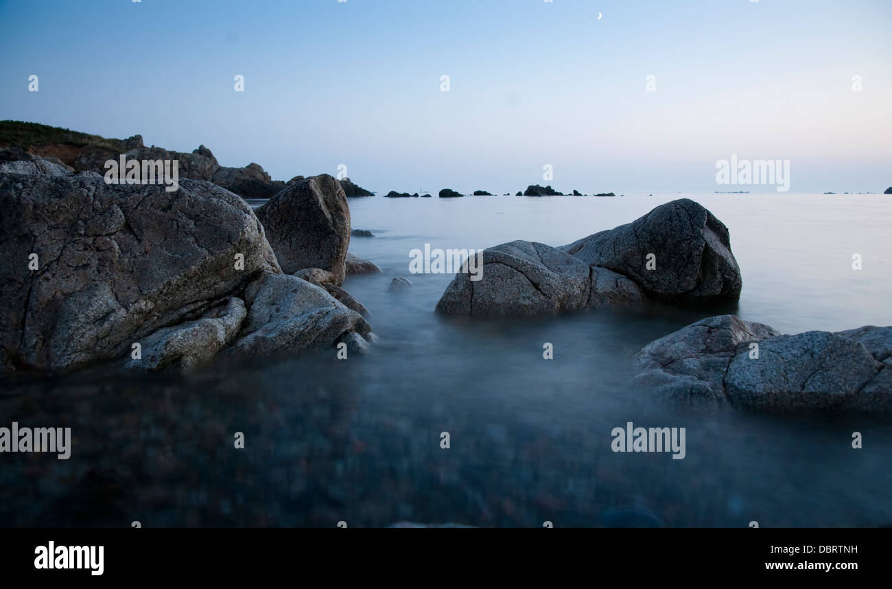 L'Erée rocks tide island guernsey channel islands - Stock Image